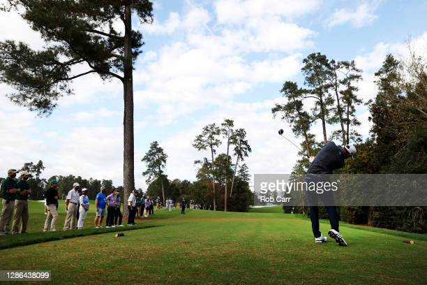 Dustin Johnson of the United States tees off on the 18th tee during the final round of the Masters at Augusta National Golf Club on November 15, 2020...