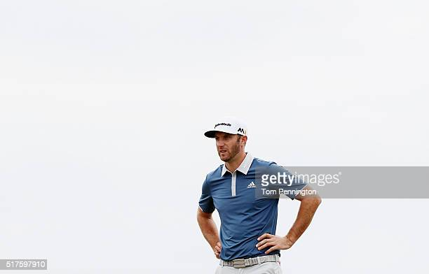 Dustin Johnson of the United States waits on the seventh hole during the round of 16 in the World Golf ChampionshipsDell Match Play at the Austin...