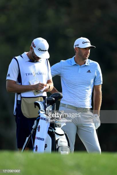 Dustin Johnson of the United States waits to play a shot on the 14th hole during the first round of The PLAYERS Championship on The Stadium Course at...