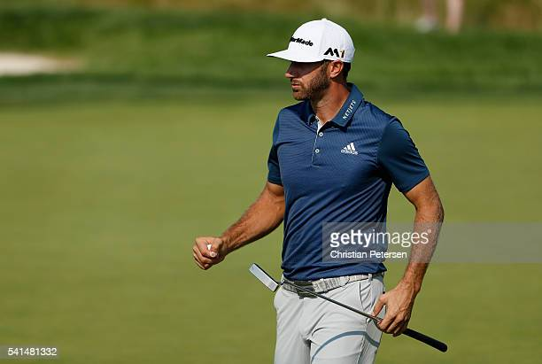Dustin Johnson of the United States walks across the eighth green during the final round of the US Open at Oakmont Country Club on June 19 2016 in...