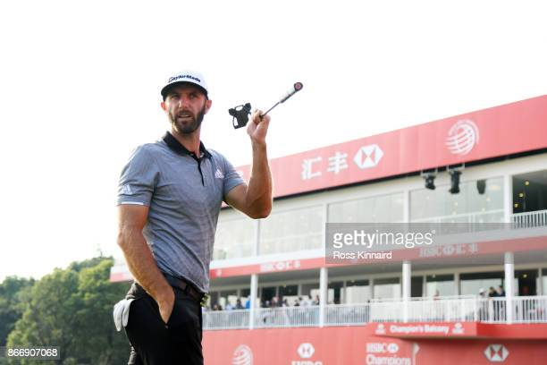 Dustin Johnson of the United States walks from the 18th green during the second round of the WGC HSBC Champions at Sheshan International Golf Club on...