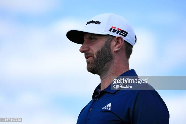 Dustin Johnson of the United States walks from the first tee during the final round of The Northern Trust at Liberty National Golf Club on August 11...