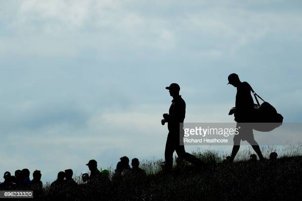 Dustin Johnson of the United States walks from the tenth tee during the first round of the 2017 US Open at Erin Hills on June 15 2017 in Hartford...
