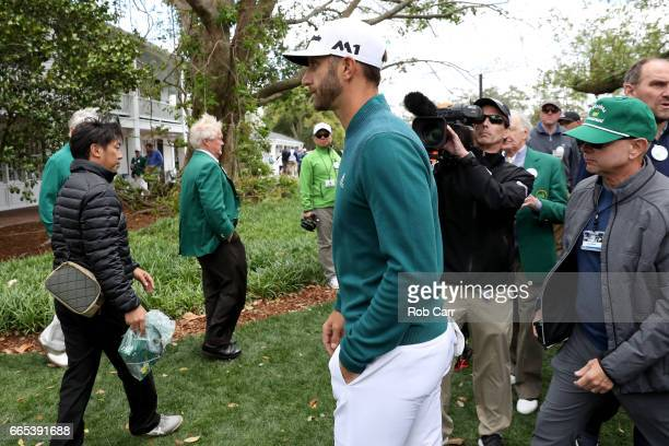 Dustin Johnson of the United States walks off after announcing his withdrawl to the media during the first round of the 2017 Masters Tournament at...