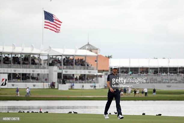 Dustin Johnson of the United States walks on the tenth hole fairway during the final round of the World Golf ChampionshipsCadillac Championship at...