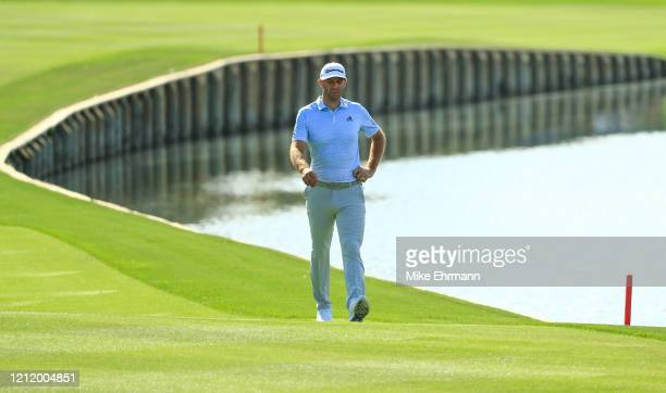 Dustin Johnson of the United States walks to the 18th green during the first round of The PLAYERS Championship on The Stadium Course at TPC Sawgrass...