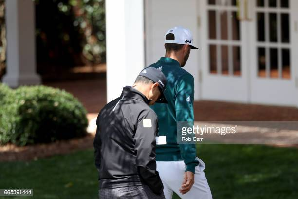 Dustin Johnson of the United States walks to the clubhouse after announcing his withdrawl during the first round of the 2017 Masters Tournament at...