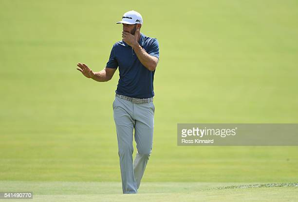 Dustin Johnson of the United States walks to the first green during the final round of the US Open at Oakmont Country Club on June 19 2016 in Oakmont...