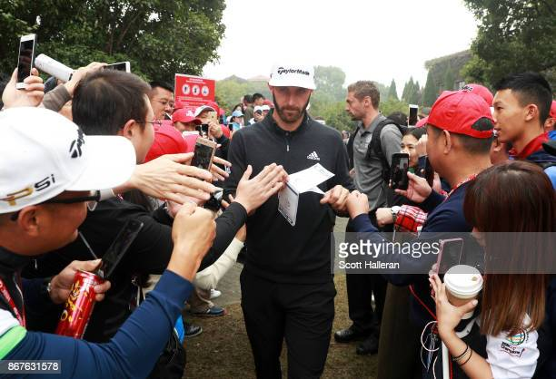 Dustin Johnson of the United States walks to the first tee during the final round of the WGC HSBC Champions at Sheshan International Golf Club on...