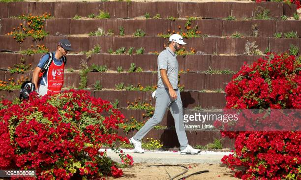 Dustin Johnson of the United States walks with his caddie and brother Austin walk to the seventh tee during Day Three of the Abu Dhabi HSBC Golf...