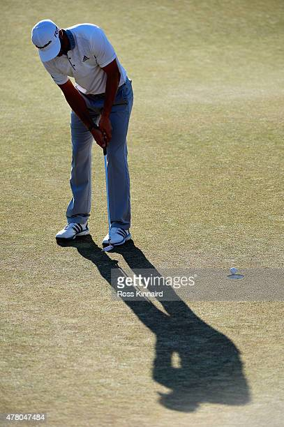 Dustin Johnson of the United States watches a missed birdie putt on the 18th green during the final round of the 115th U.S. Open Championship at...