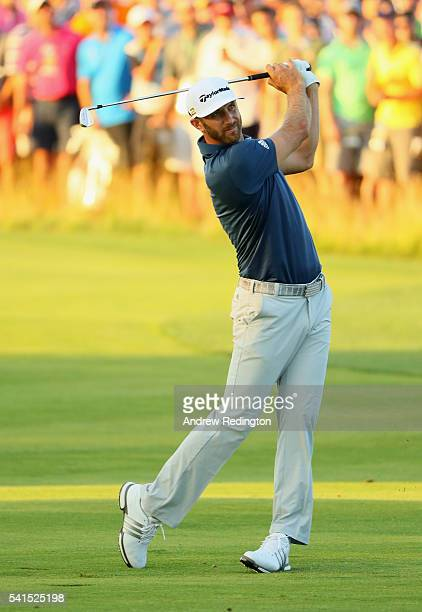 Dustin Johnson of the United States watches his second shot on the 18th hole during the final round of the US Open at Oakmont Country Club on June 19...