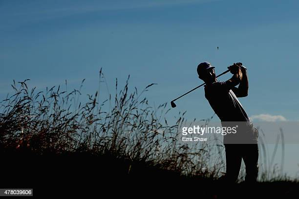 Dustin Johnson of the United States watches his tee shot on the 12th hole during the final round of the 115th US Open Championship at Chambers Bay on...