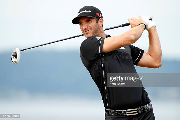 Dustin Johnson of the United States watches his tee shot on the 18th hole during the first round of the 115th US Open Championship at Chambers Bay on...