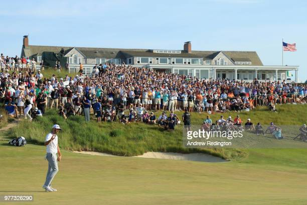 Dustin Johnson of the United States waves after putting on the 18th green during the final round of the 2018 US Open at Shinnecock Hills Golf Club on...