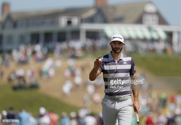Dustin Johnson of the United States waves on the first green during the third round of the 2018 US Open at Shinnecock Hills Golf Club on June 16 2018...