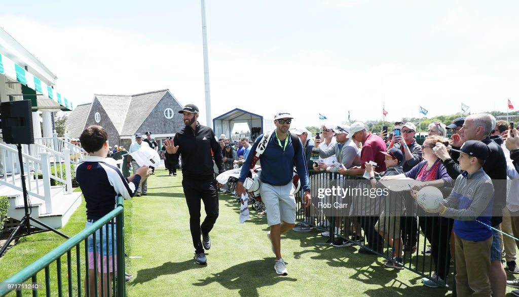 Dustin Johnson of the United States waves to fans during practice rounds prior to the 2018 U.S. Open at Shinnecock Hills Golf Club on June 11, 2018 in Southampton, New York.