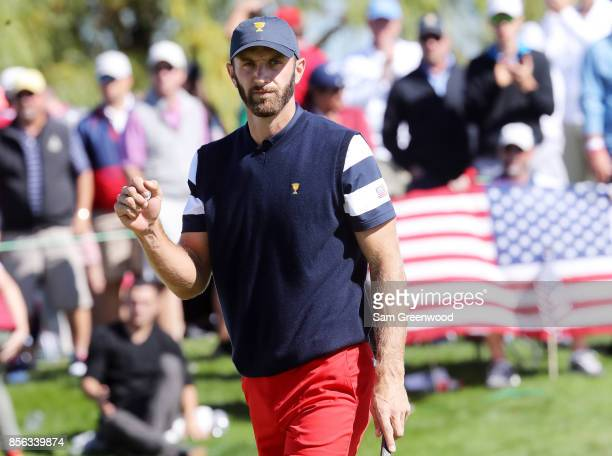 Dustin Johnson of the US Team reacts on the third green during Sunday singles matches of the Presidents Cup at Liberty National Golf Club on October...