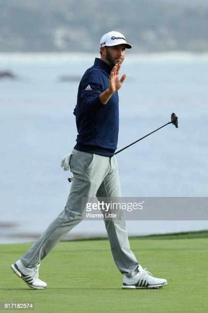 Dustin Johnson of the USA acknowledges the crowd on the 18th green during the final round of the ATT Pebble Beach ProAm the Pebble Beach Golf Links...