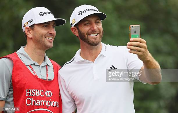 Dustin Johnson of the USA and his brother/caddie Austin take a selfie during the Pro Am prior to the start of the WGC HSBC Champions at the Sheshan...
