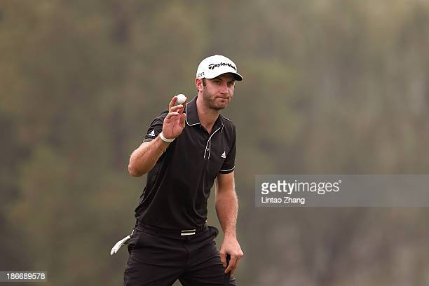 Dustin Johnson of the USA celebrates after chiipping in for an eagle on the 16th hole during the final round of the WGC HSBC Champions at the Sheshan...