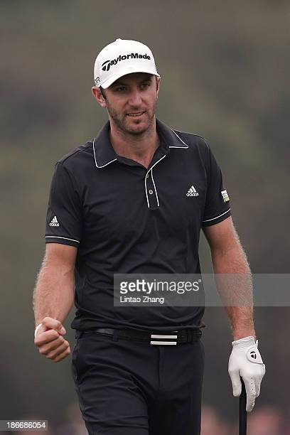 Dustin Johnson of the USA celebrates after chipping in for an eagle on the 16th hole during the final round of the WGC HSBC Champions at the Sheshan...