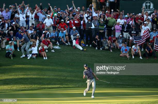 Dustin Johnson of the USA celebrates his birdie putt on the 17th green during day two of the Afternoon FourBall Matches for The 39th Ryder Cup at...
