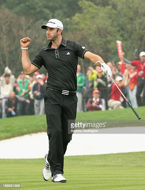 Dustin Johnson of the USA celebrates his chip in eagle on the 16th hole during the final round of the WGC HSBC Champions at the Sheshan International...