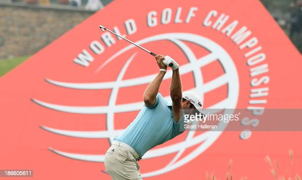 Dustin Johnson of the USA hits his approach shot on the ninth hole during the third round of the WGCHSBC Champions at the Sheshan International Golf...