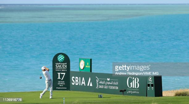 Dustin Johnson of the USA hits his teeshot on the 17th hole on Day Three of the Saudi International at Royal Greens Golf and Country Club on February...
