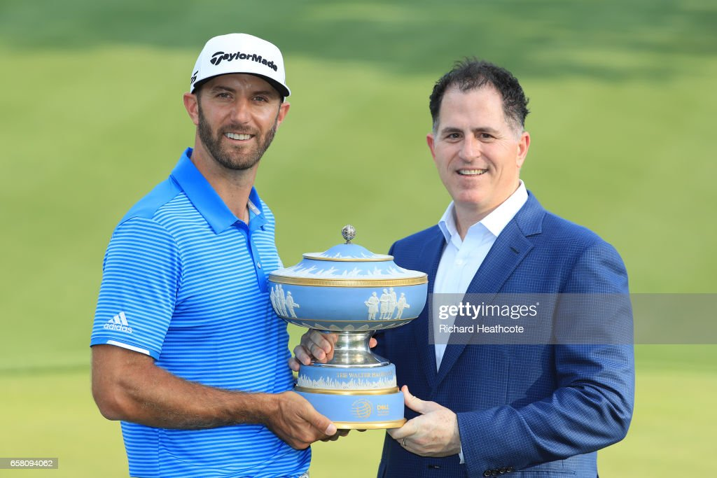 Dustin Johnson of the USA is presented with the trophy by Michael Dell, Chairman and CEO of Dell Technologies, after winning the World Golf Championships-Dell Technologies Match Play at the Austin Country Club on March 26, 2017 in Austin, Texas.