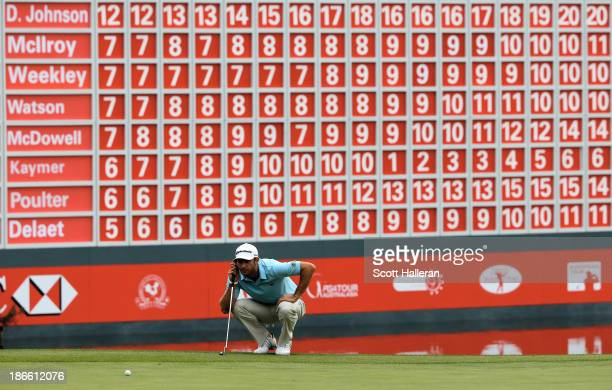 Dustin Johnson of the USA lines up a putt on the 18th green during the third round of the WGCHSBC Champions at the Sheshan International Golf Club on...
