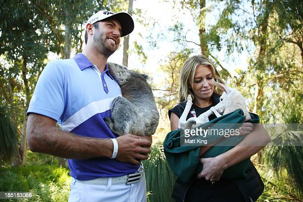 Dustin Johnson of the USA nurses a Koala with his partner Paulina Gretzky as she nurses a Joey during day two of the Perth International at Lake...