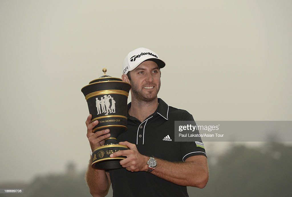 Dustin Johnson of the USA pictured with the winnner's trophy after round four of the WGC - HSBC Champions at Sheshan International Golf Club on November 3, 2013 in Shanghai, China.