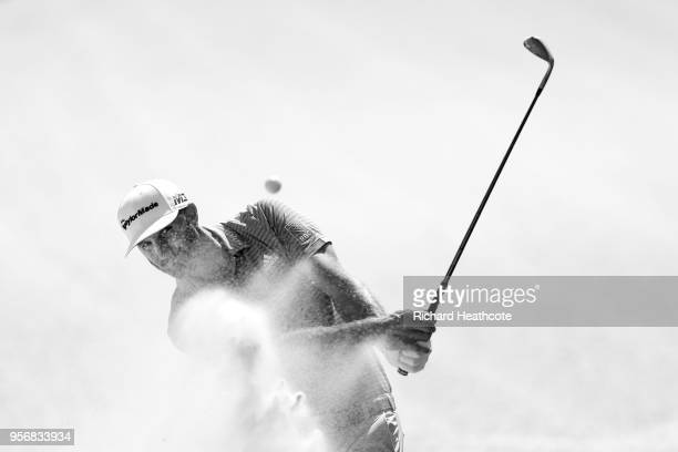 Dustin Johnson of the USA plays a shot during practice round prior to THE PLAYERS Championship on the Stadium Course at TPC Sawgrass on May 8 2018 in...
