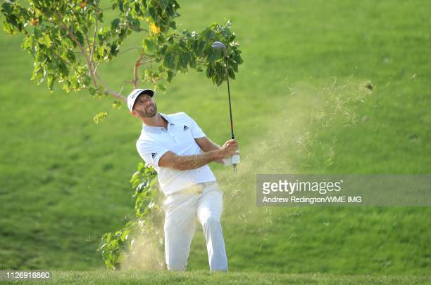 Dustin Johnson of the USA plays his second shot on the 17th hole on Day Three of the Saudi International at Royal Greens Golf and Country Club on...