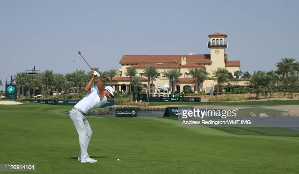 Dustin Johnson of the USA plays his second shot on the ninth hole on Day Three of the Saudi International at Royal Greens Golf and Country Club on...