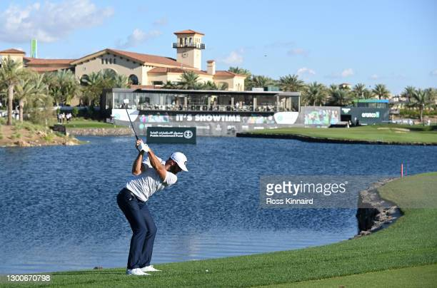 Dustin Johnson of the USA plays his second shot on the par five 18th hole1 during the third round of the Saudi International powered by SoftBank...