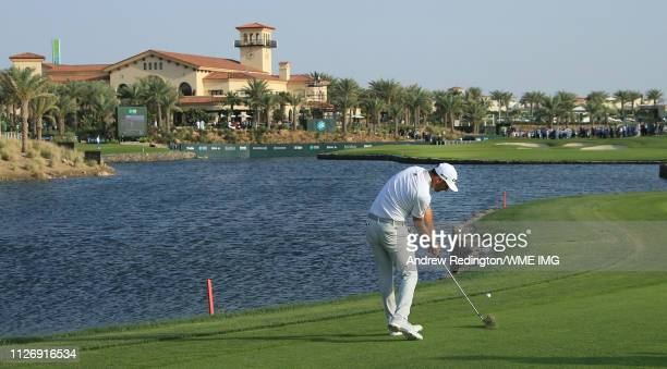 Dustin Johnson of the USA plays his third shot on the 18th hole on Day Three of the Saudi International at Royal Greens Golf and Country Club on...