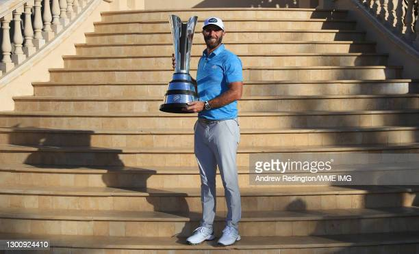 Dustin Johnson of the USA poses with the trophy after winning the Saudi International powered by SoftBank Investment Advisers at Royal Greens Golf...