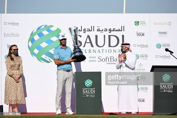 Dustin Johnson of the USA poses with the trophy during Day Four of the Saudi International powered by SoftBank Investment Advisers at Royal Greens...