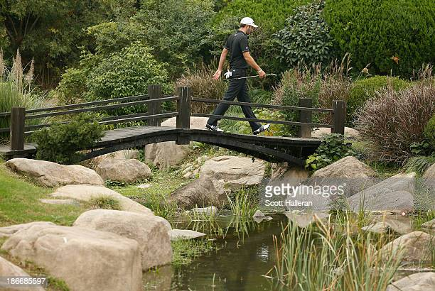 Dustin Johnson of the USA walks to the eighth green during the final round of the WGCHSBC Champions at the Sheshan International Golf Club on...