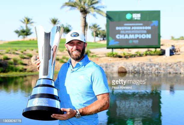 Dustin Johnson of the USA with the winners trophy after the final round of the Saudi International powered by SoftBank Investment Advisers at Royal...