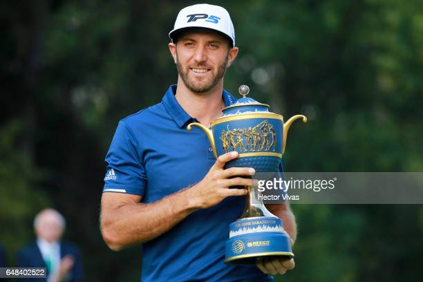 Dustin Johnson of United States holds the trophy during the final round of the World Golf Championships Mexico Championship at Club De Golf...