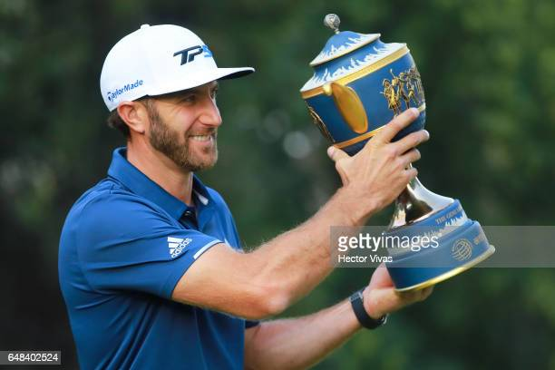 Dustin Johnson of United States lifts the trophy during the final round of the World Golf Championships Mexico Championship at Club De Golf...