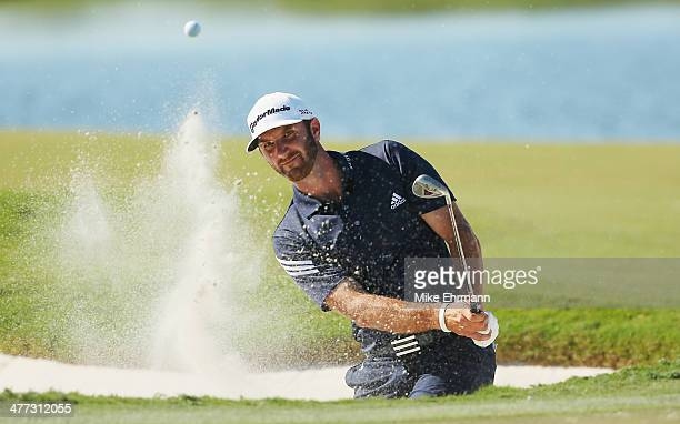 Dustin Johnson plays a bunker shot on the eighth hole during the third round of the World Golf Championships-Cadillac Championship at Trump National...