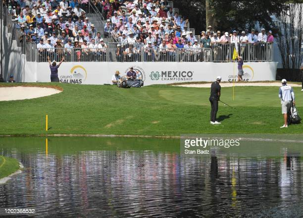 Dustin Johnson plays a chip shot on the sixth hole during the second round of the World Golf Championships-Mexico Championship at Club de Golf...