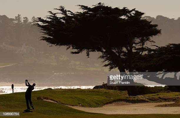 Dustin Johnson plays a shot during the first round of the ATT Pebble Beach National ProAm at Monterey Peninsula Country Club on February 10 2011 in...