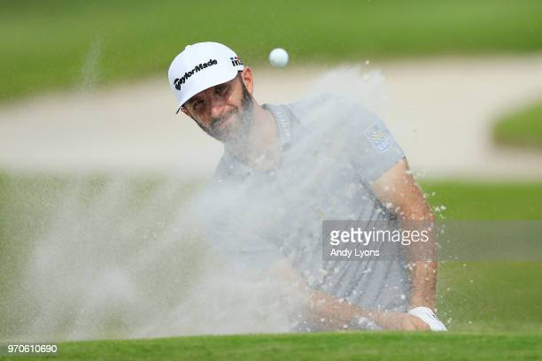 Dustin Johnson plays a shot from a bunker on the 16th hole during the third round of the FedEx St. Jude Classic at TPC Southwind on June 9, 2018 in...