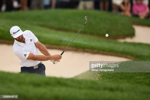 Dustin Johnson plays a shot from a bunker on the 18th hole during the third round at the RBC Canadian Open at Glen Abbey Golf Club on July 28, 2018...